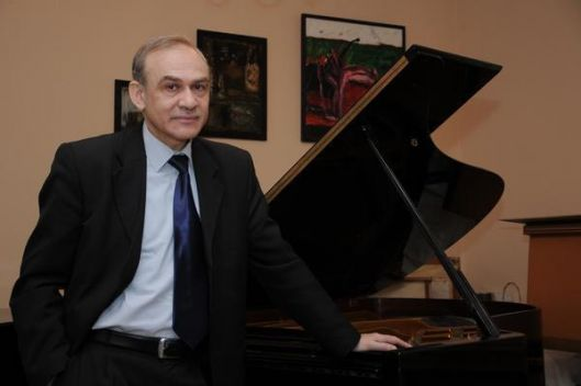University professor at the Department of Musicology, Composition, Jazz music of the Academy of Music, Theater and Fine Arts in Chisinau